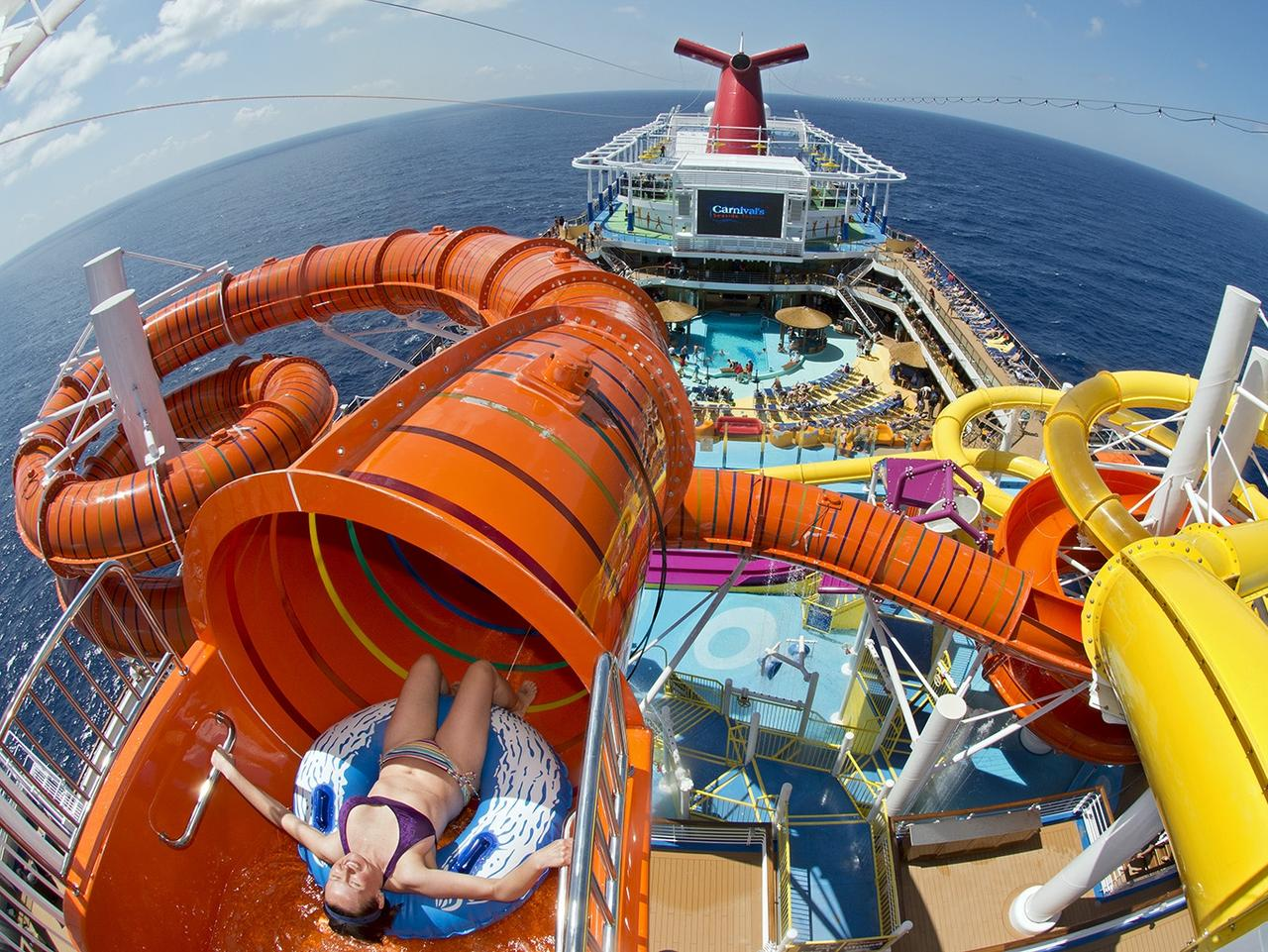 A guest onboard Carnival Vista slides down Kaleid-O-Slide, a water tube attraction situated amid WaterWorks, the ship's onboard water park. (Photo by Andy Newman/Carnival Cruise Line). Sunday Escape