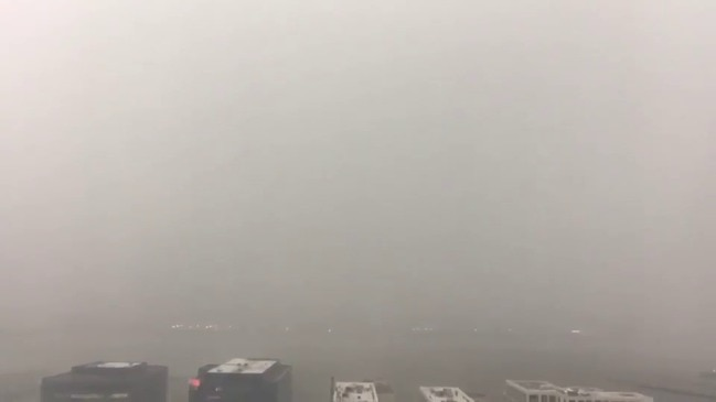 Lightning Flashes as Storm Obscures New York City Skyline