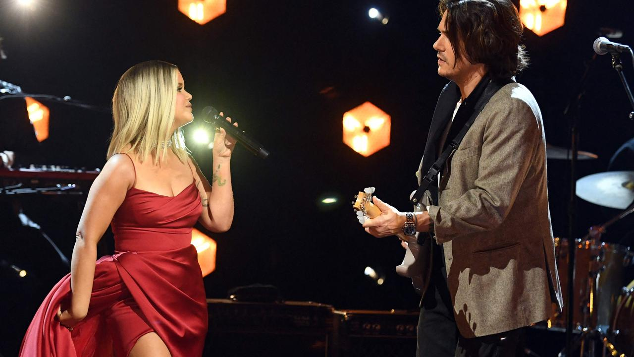 John Mayer joined Morris on stage for her performance of The Bones. Picture: AFP Photo.