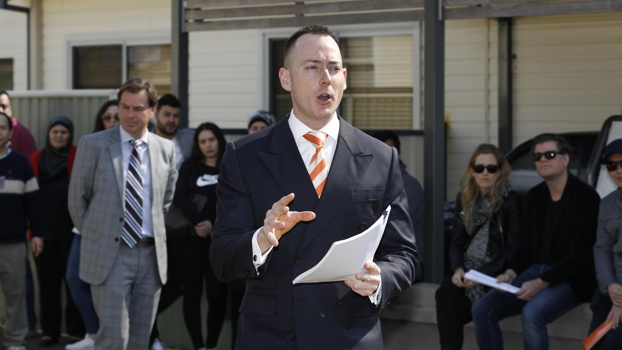 Auctioneer Andrew Cooley at the sale of 28 Panania Ave, Panania. Picture: Chris Pavlich