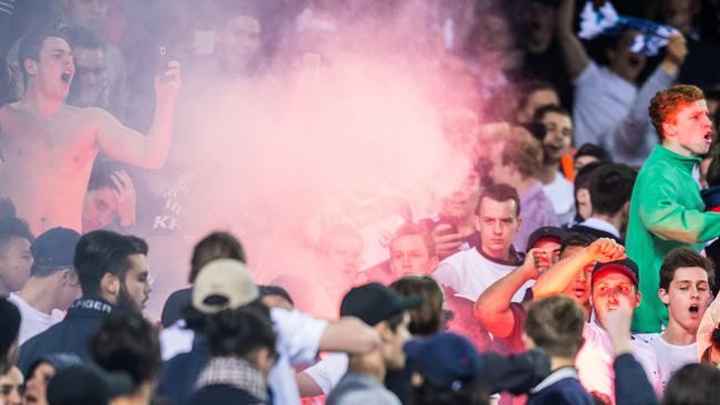 A flare is set off in the Melbourne derby after Melbourne Victory's Marco Rojas scored.