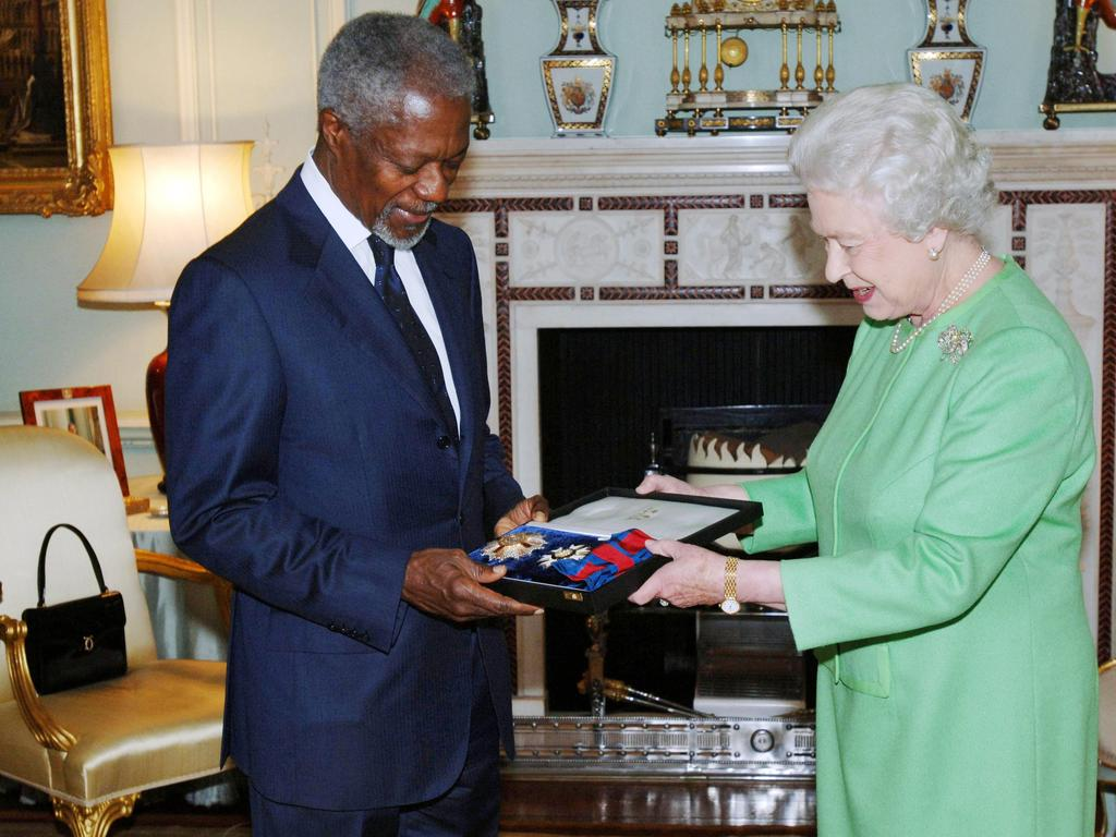 Queen Elizabeth II investing the former Secretary-General of the United Nations Kofi Annan with an honorary Grand Cross of the order of St. Michael and St. George knighthood at Buckingham Palace in 2007. Picture: AP