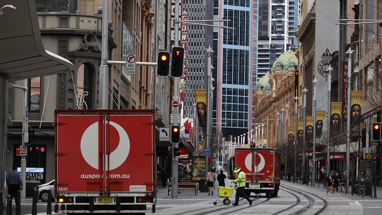 Australian Post employees in the city. The Sydney CBD remains quiet during Covid-19 Lockdown. Picture: NCA NewsWire / Dylan Coker