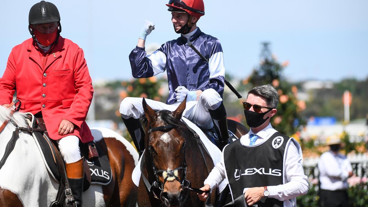 Jye McNeil returns to the mounting yard aboard Twilight Payment. Natasha Morello/Racing Photos via Getty Images