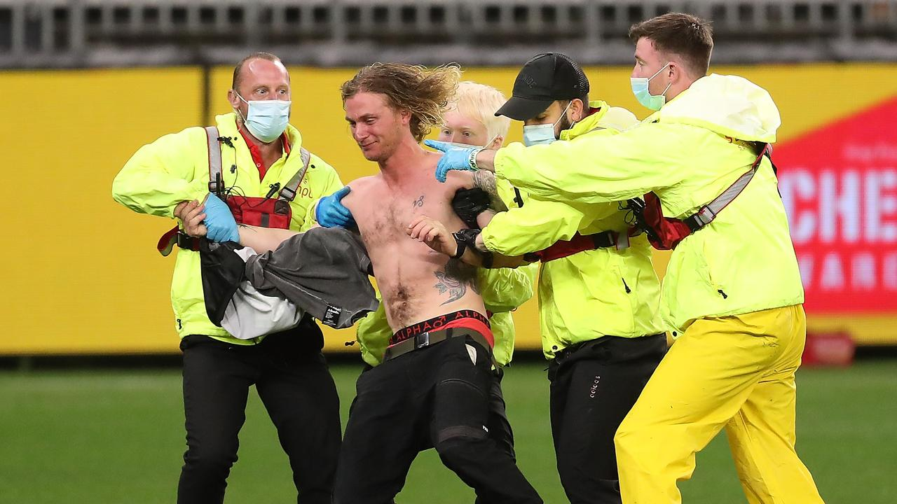 A pitch invader during the Geelong-Collingwood at Optus Stadium has been fined. Picture: Paul Kane