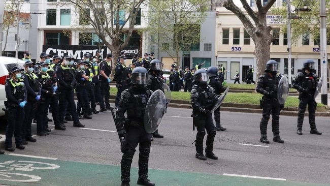 Victoria Police stand outside the CFMEU Office on Wednesday as they use new tactics to disperse the crowds. Picture: Getty Images