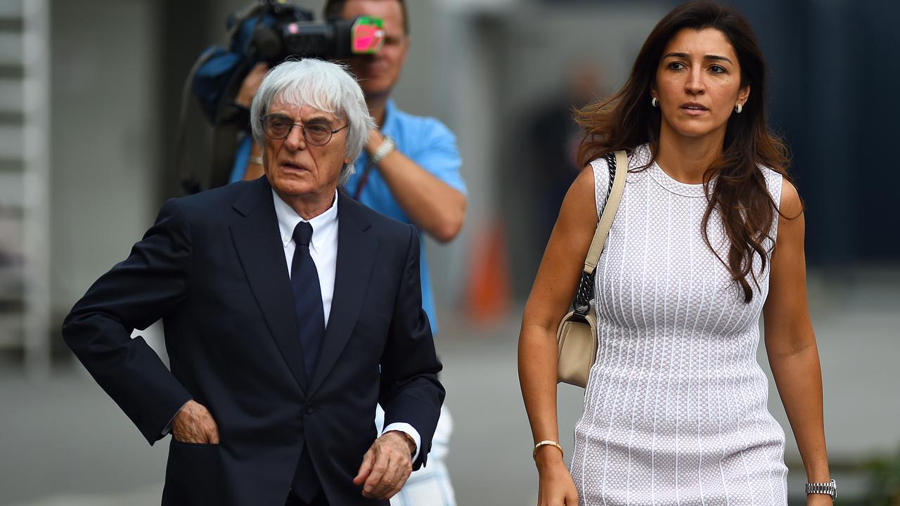 F1 supremo Bernie Ecclestone walks through the paddock with his wife Fabiana Flosi. (Photo by Lars Baron/Getty Images)