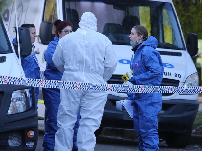 Police forensics officers at the scene today. Picture: John Grainger