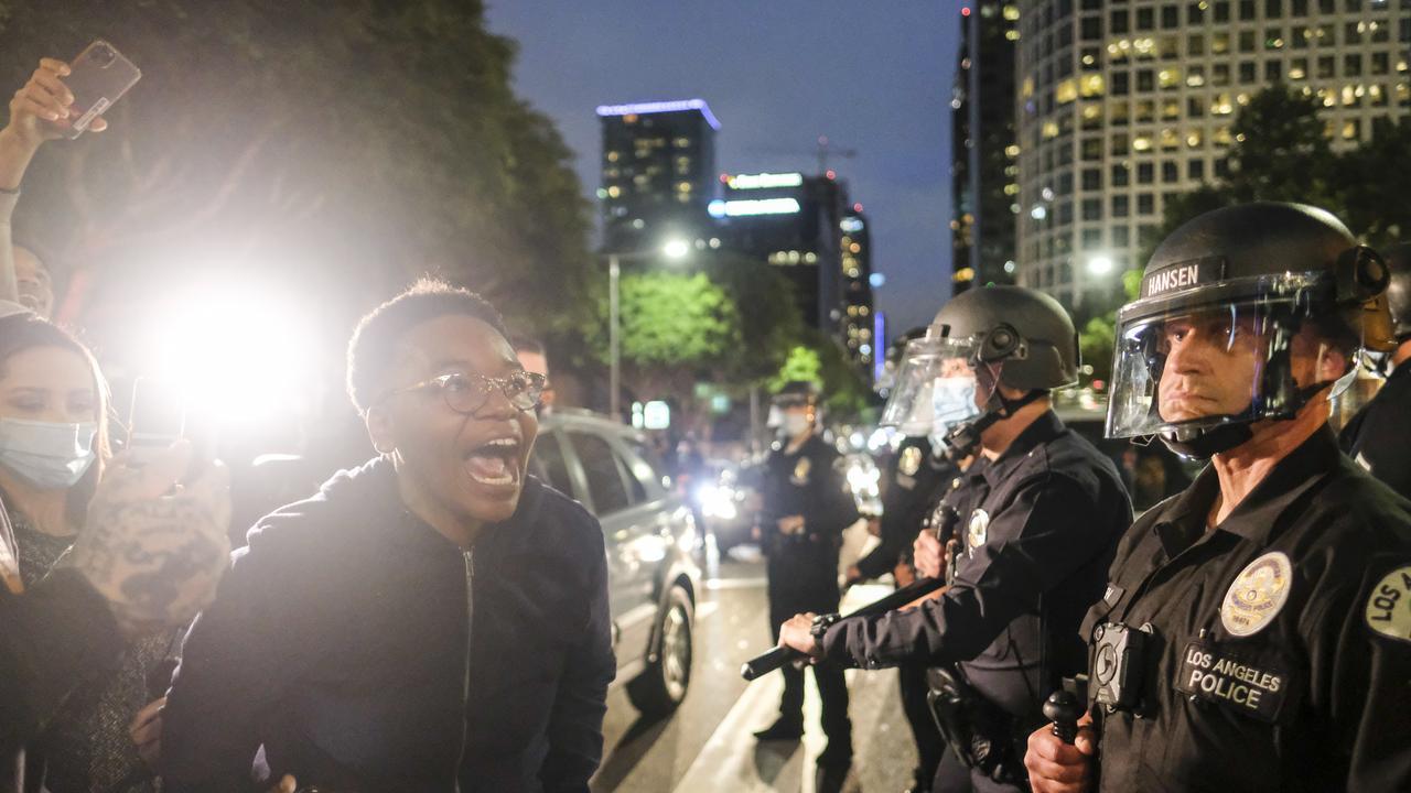 A protester screams at police. Picture: Ringo H.W. Chiu/AP