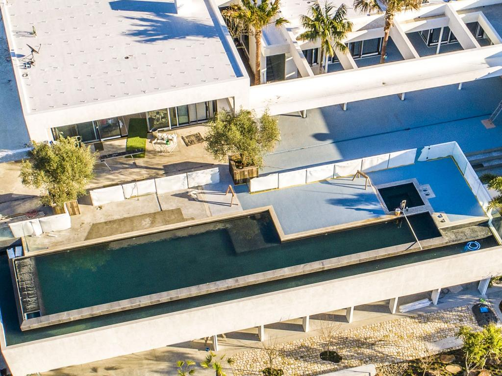 The home includes a spectacular infinity pool. Picture: MEDIA-MODE.COM