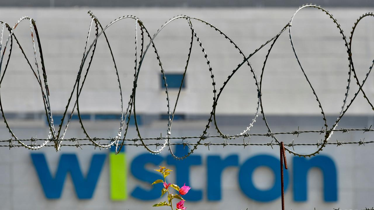 The logo of Wistron, a Taiwanese-run iPhone factory where workers protested and that Apple is now probing. Picture: Manjunath Kiran / AFP