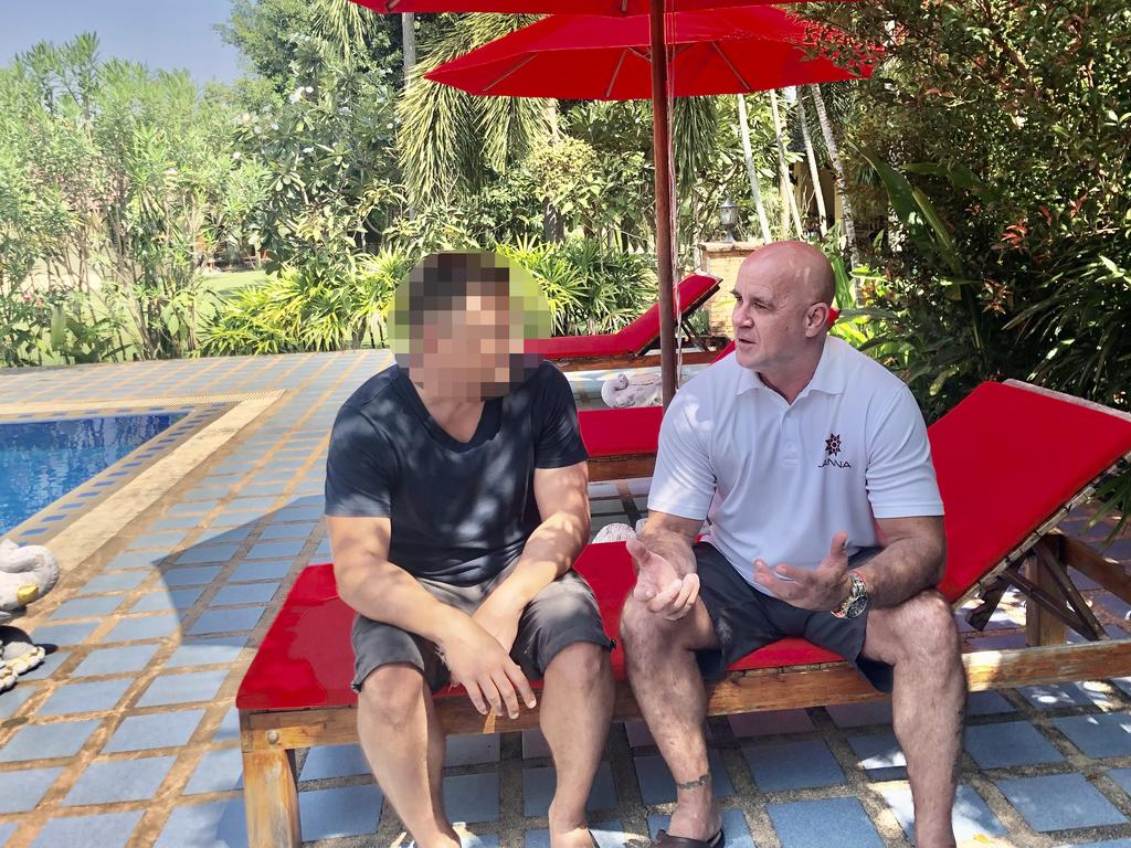 Keith with Lanna CEO Darren Lockie, sitting next to the centre's outdoor swimming pool.