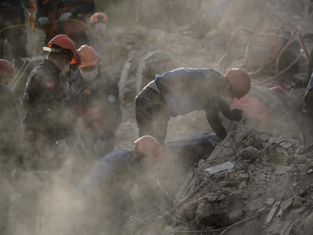 Rescue workers search for victims. Picture: Ozan Kose / AFP