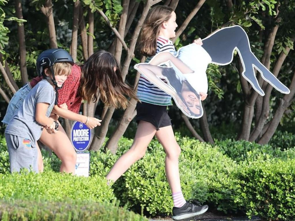 The Affleck children playing with the same cardboard cutout last year. Picture: X17