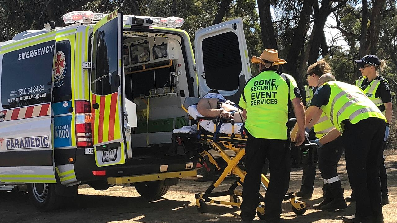 A man is loaded into an ambulance at Rainbow Serpent Festival in February.