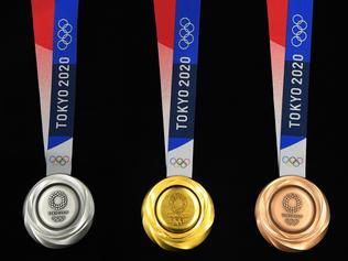 """TOKYO, JAPAN - JULY 24: The silver, gold and bronze medals are displayed after the Tokyo 2020 medal design unveiling ceremony during Tokyo 2020 Olympic Games """"One Year To Go"""" ceremony at Tokyo International Forum on July 24, 2019 in Tokyo, Japan. (Photo by Atsushi Tomura/Getty Images)"""