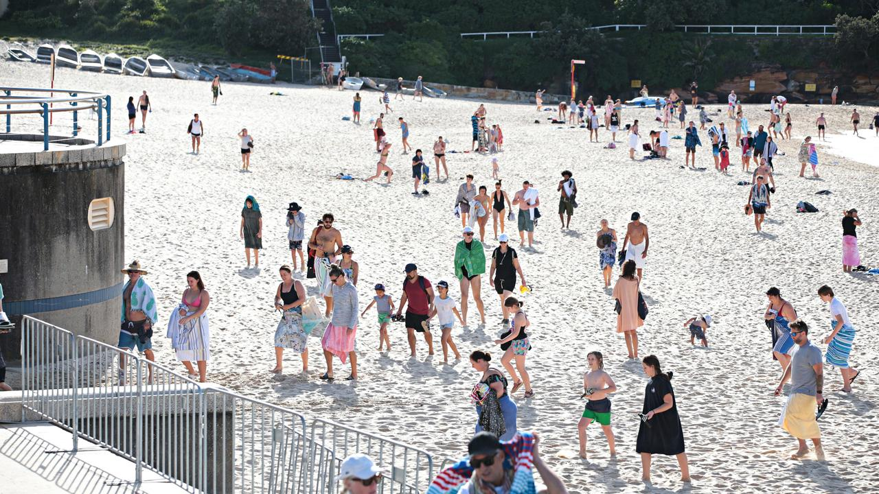 Large crowds leaving Coogee beach after 9am closure on April 26. Picture: Adam Yip