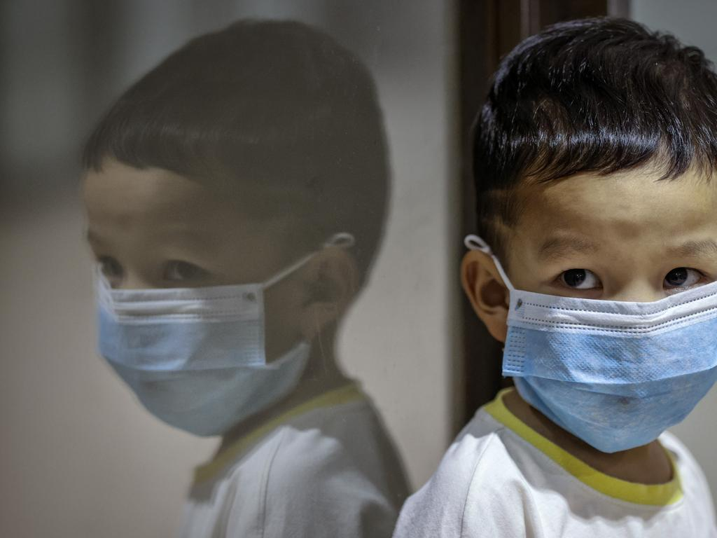 MANILA, PHILIPPINES - FEBRUARY 03: A child is seen wearing a facemask, as public fear over China's Wuhan Coronavirus grows, at the Ninoy Aquino International Airport on February 3, 2020 in Manila, Philippines. The Philippine government has been heavily criticized after failing to immediately implement travel restrictions on China, the source of a deadly coronavirus that has now killed more than 300 people and infected thousands more. On Sunday, the first coronavirus death outside of China was reported in the Philippines. (Photo by Ezra Acayan/Getty Images) *** BESTPIX ***