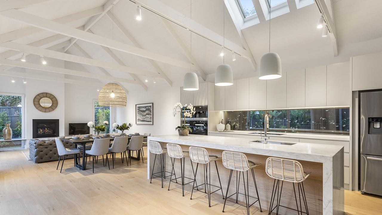 A soaring cathedral ceiling adds wow factor to the open-plan living, dining and kitchen area.