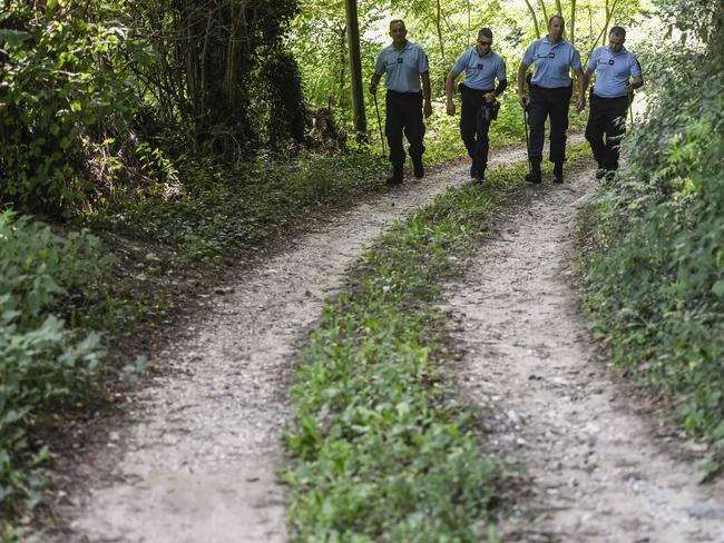 French gendarmes search for evidences in the area around Pont-de-Beauvoisin, eastern France, after Maelys, a 9-year-old girl, disappeared during a wedding party. Picture: AFP