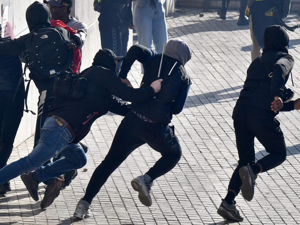 Police officers chase demonstrators on December 6 in Marseilles. Picture: Gerard Julien/AFP