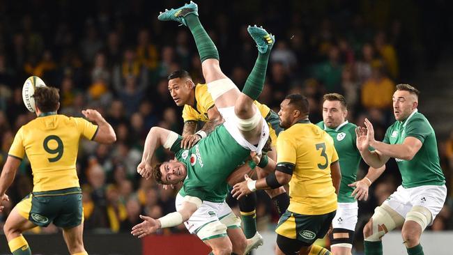 Ireland's Peter O'Mahony and Australia's Israel Folau jump for the ball.