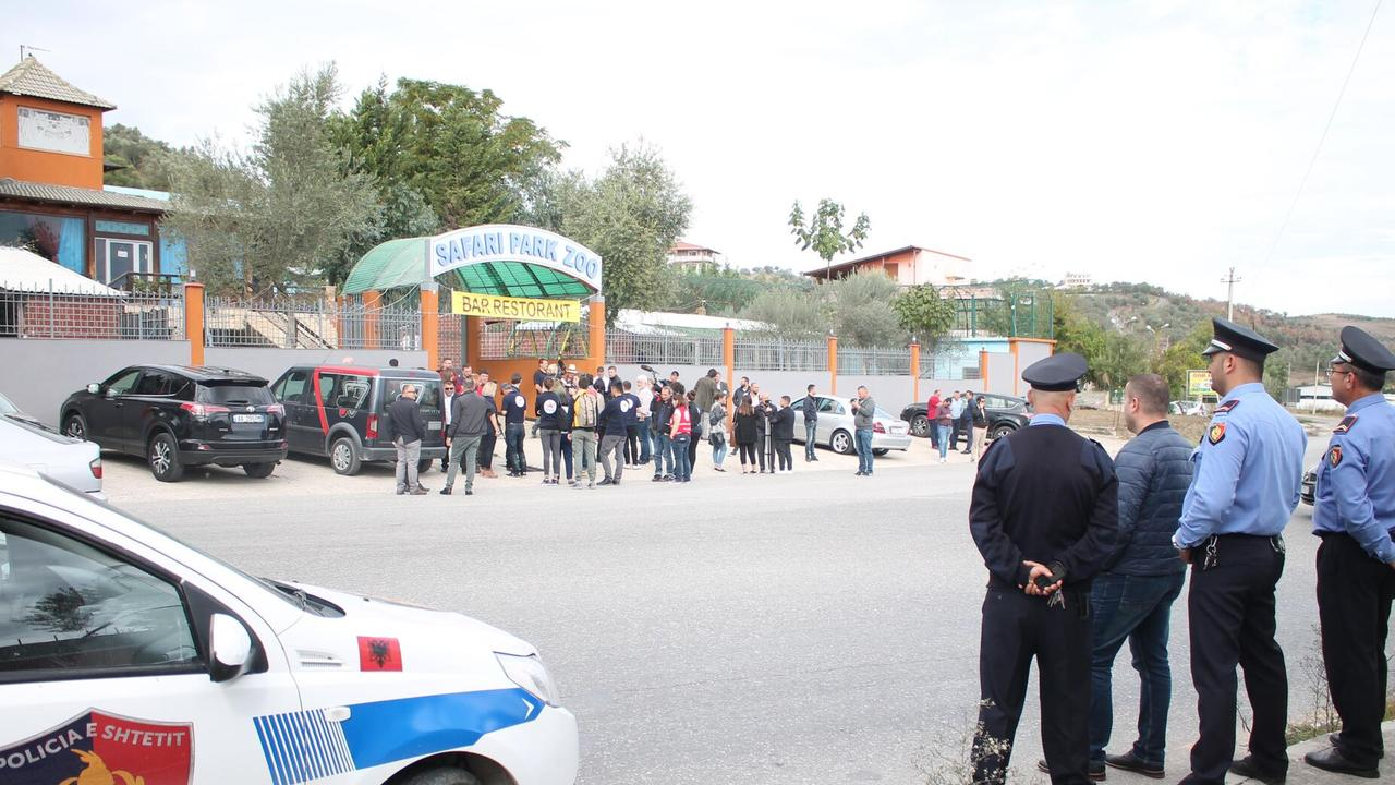 Police at the entrance of the zoo dubbed 'Europe's worst zoo' and the 'zoo from hell'.