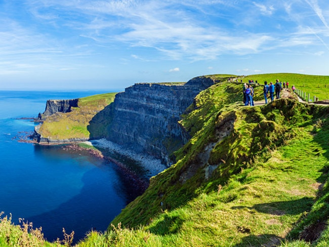 Tourists at the Cliffs of Moher, The Burren, County Clare, Republic of Ireland