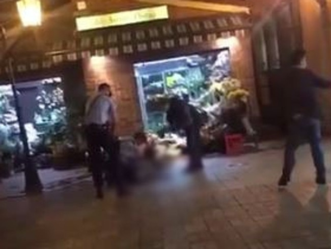 Video posted on social media shows the man run out of the florist towards police, before he is fatally shot. Picture: Twitter.