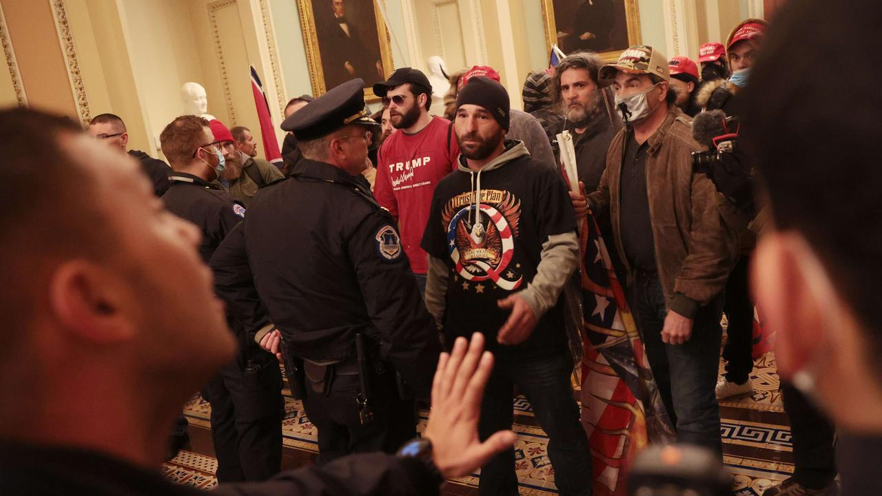Protesters interact with Capitol Police inside the Capitol Building during the siege on January 6. Picture: Win McNamee/Getty Images/AFP