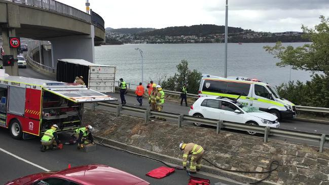 Traffic snarl as truck loses container in Tasman Bridge crash | The
