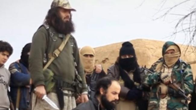 An ISIS propaganda film, showing what is believed to be Khaled Sharrouf standing over a prisoner.
