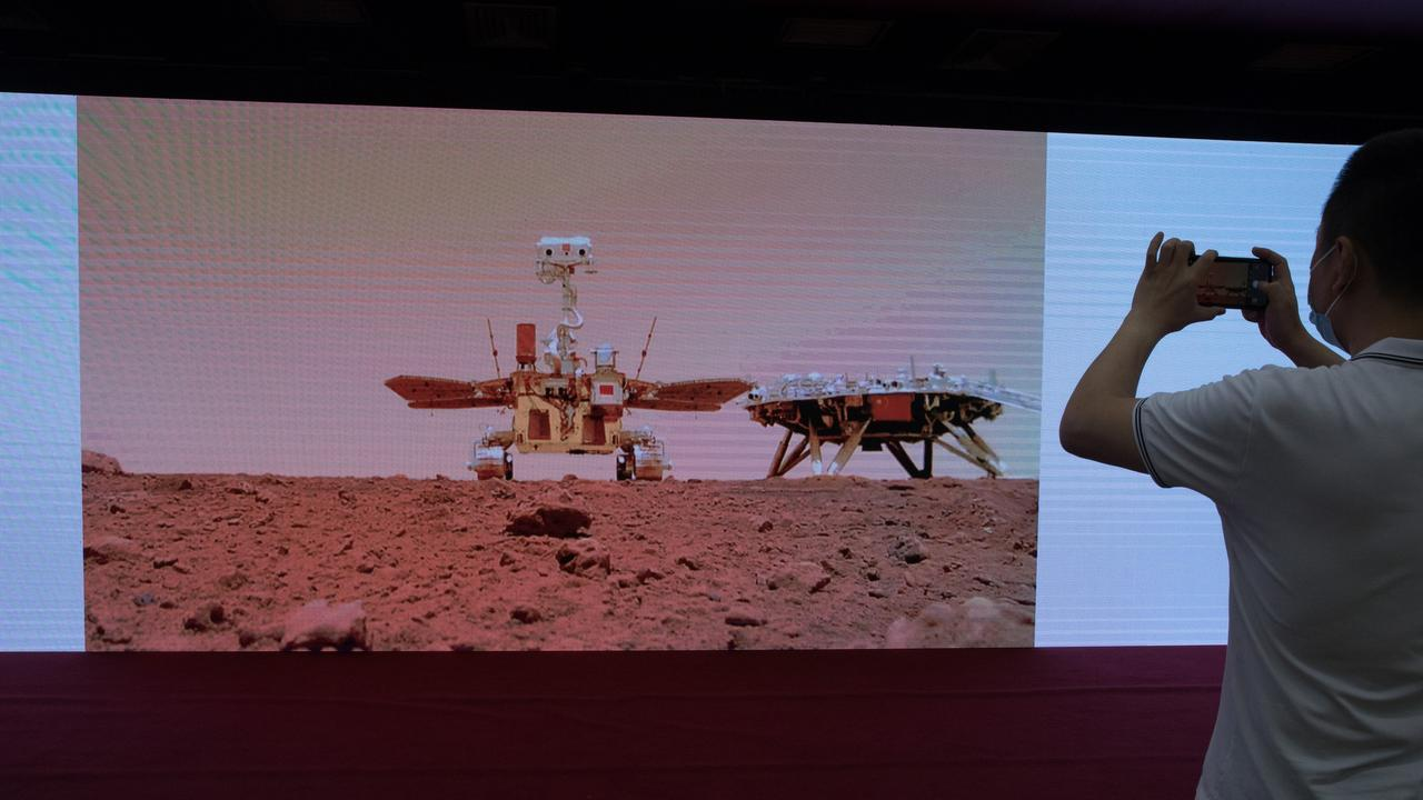New images taken by China's first Mars rover Zhurong are unveiled in the capital Beijing on June 11, marking the success of China's first Mars exploration mission. Picture: Jin Liwang/Xinhua via Getty Images.