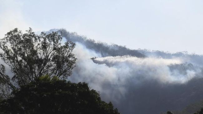 Waterbombing aircraft are being used to battle the Kilkivan blaze.