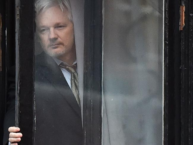 WikiLeaks founder Julian Assange coming out on the balcony of the Ecuadorean embassy in 2016. Picture: AFP