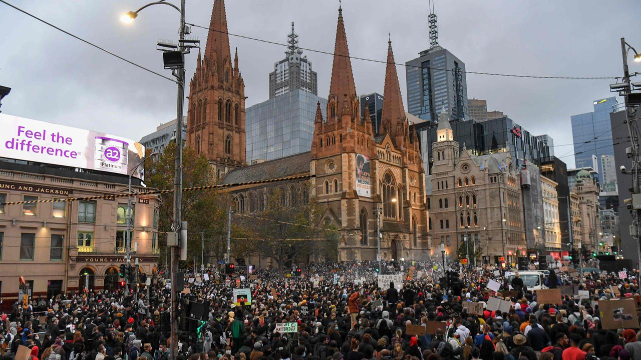 Demonstrators attend a Black Lives Matter protest to express solidarity with US protesters in Melbourne on Saturday and demand an end to frequent Aboriginal deaths in custody in Australia. William WEST/AFP
