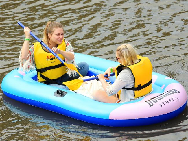Participants float down the Yarra River for the Melbourne Inflatable Regatta. Picture: Mark Stewart