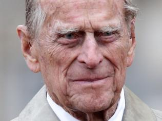 Britain's Prince Philip, Duke of Edinburgh, in his role as Captain General, Royal Marines, attends a Parade to mark the finale of the 1664 Global Challenge on the Buckingham Palace Forecourt in central London on August 2, 2017.   Prince Philip, the 96-year-old husband of Queen Elizabeth II, conducted his final solo public engagement on August 2, 2017, overseeing a military parade in the pouring rain before retiring from a lifetime of service. The Duke of Edinburgh, wearing a raincoat and bowler hat, met members of the Royal Marines and veterans -- many younger than him -- before taking the salute in the forecourt of Buckingham Palace.   / AFP PHOTO / POOL / Yui Mok