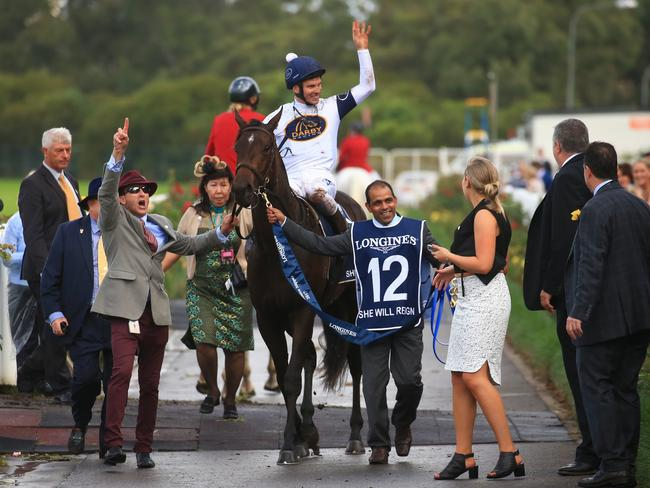 Jockey Ben Melham and She Will Reign return to scale victorious. Picture: Adam Taylor
