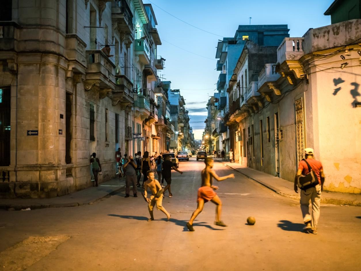 cuban kids playing street soccer in Central Havana