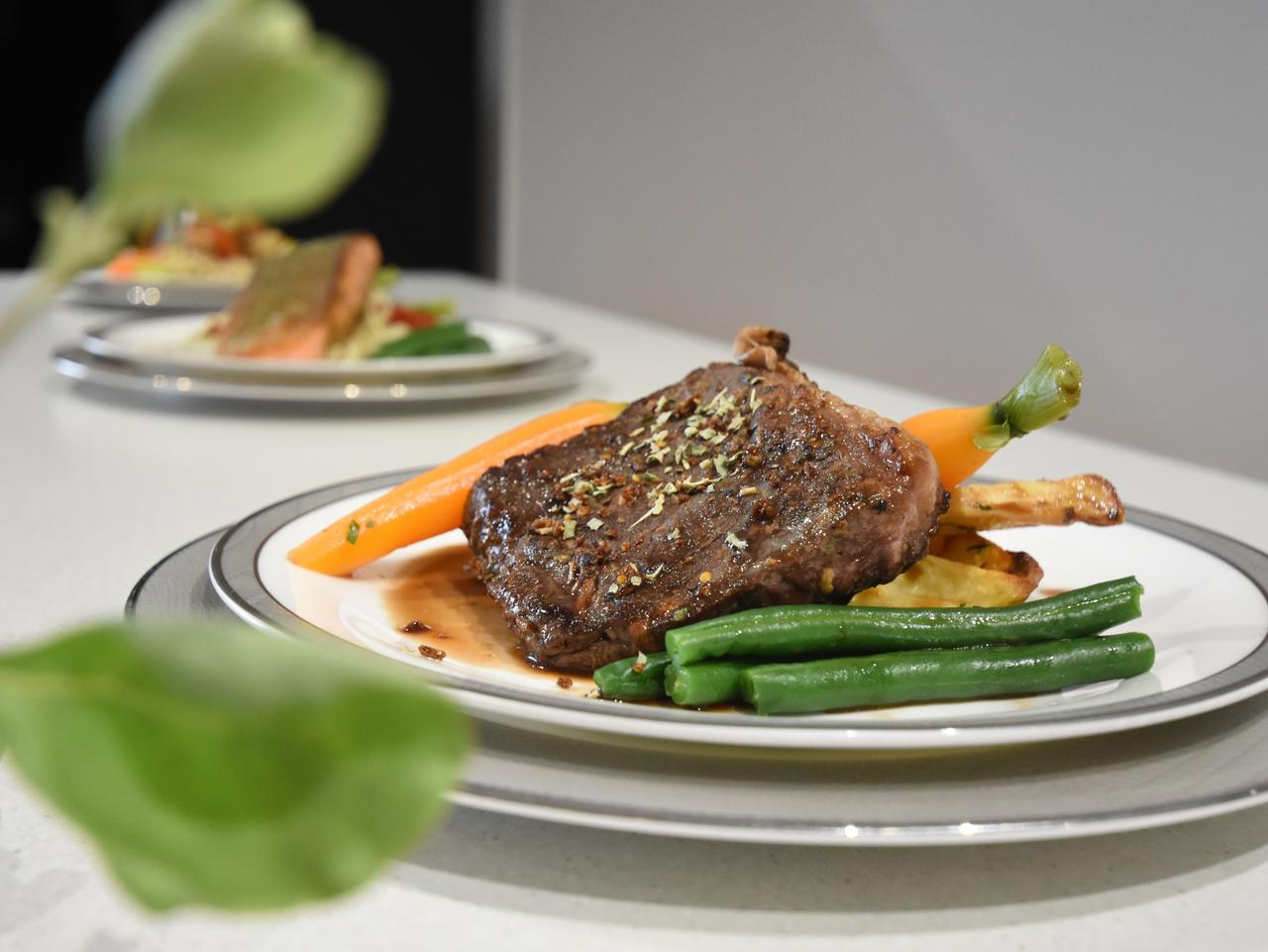 ESCAPE: The salt bush & wild tomato seasoned Jack's Creek wagyu sirloin dish for first class passengers at the tour through airline food caterer Gate Gourmet's Mascot base in Sydney during the launch of Singapore Airline's new 50th Anniversary menu. Picture: Simon Tsang