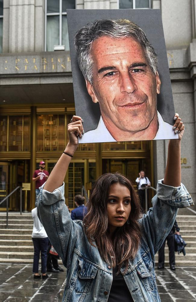 In this file photo taken on July 8, 2019, a protest group called 'Hot Mess' hold up photos of Jeffrey Epstein in front of the Federal courthouse in New York City. Picture: Stephanie Keith / Getty Images North America / AFP