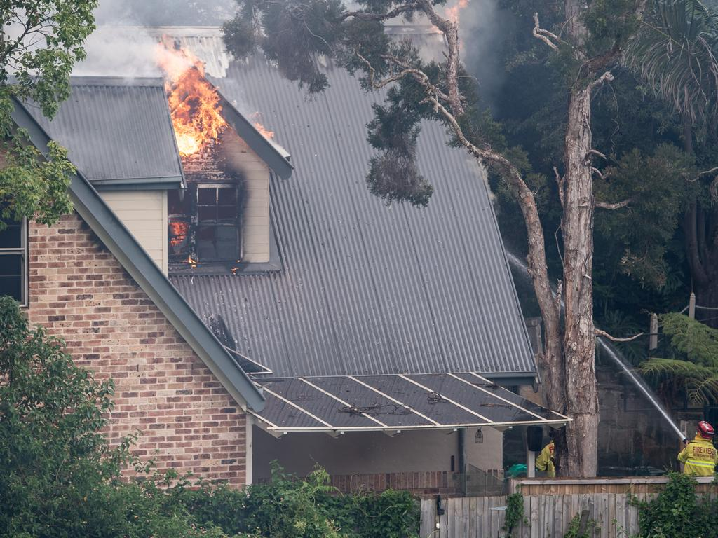 NSW firefighters were kept busy on Sunday, where a bushfire burning near Northmead spread to nearby houses. Picture: NCA NewsWire / James Gourley