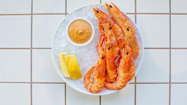 Grab bar bites like fresh prawns on ice at the bar. Picture: Destination Gold Coast