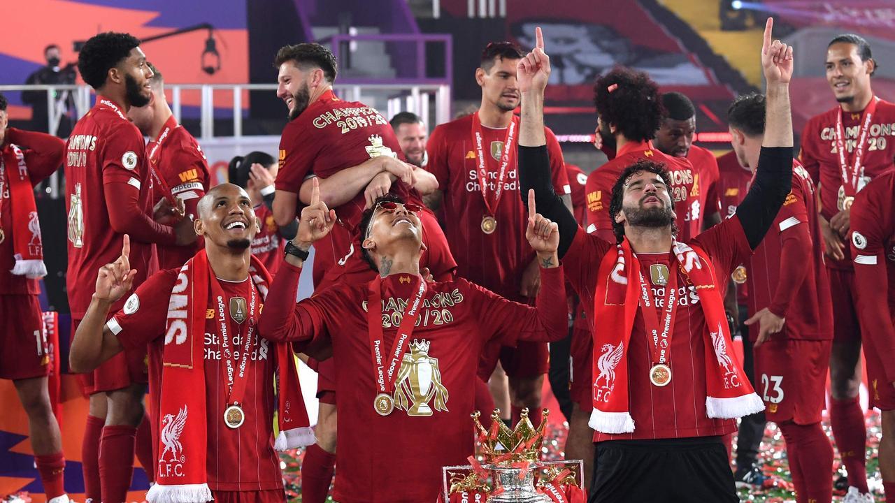 Liverpool's Brazilian trio of Fabinho, Firmino and Alisson (L-R) celebrating the Premier League title.