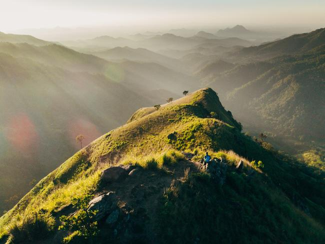 TAKE THE EASIER OPTION If a six-hour vertical hike in the dark isn't your thing, you can climb Little Adam's Peak instead! It's one of the country's most popular treks, with plenty of bang for your buck. Investment: a moderate 45-minute hike. The reward: spectacular 360-degree views of surrounding mountains, serpentine roads, and tea fields.