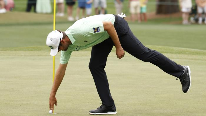 AUGUSTA, GEORGIA - APRIL 10: Corey Conners of Canada reacts on the sixth green after hitting a hole-in-one during the third round of the Masters at Augusta National Golf Club on April 10, 2021 in Augusta, Georgia. (Photo by Jared C. Tilton/Getty Images)