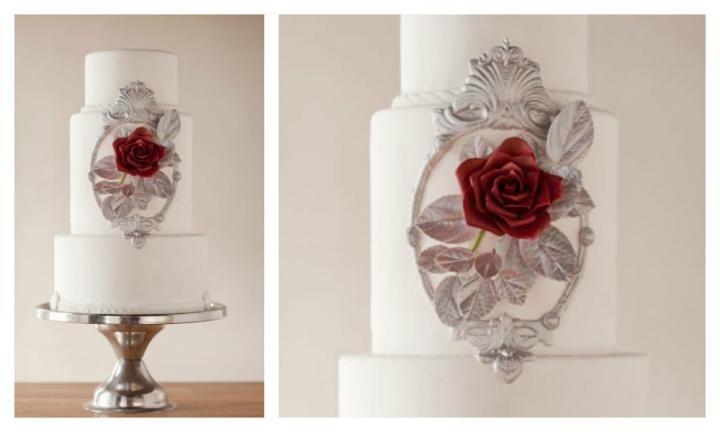 <b>BEAUTY AND THE BEAST.</b>  If you're after simple sophistication with just a hint of Disney magic, this is the wedding cake for you. The single rose is the only pop of colour with a silver foiled frame and delicate touches of white fondant icing. This is one stunning cake. <p><i>Source: Wild Orchid Baking Co.</i></p>