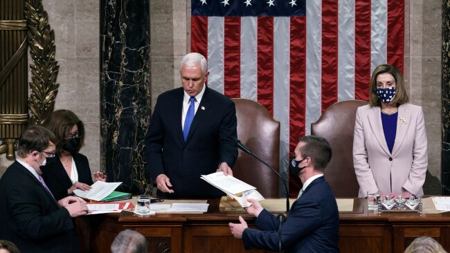 """Vice President Mike Pence and Speaker of the House Nancy Pelosi during a joint session of Congress after working through the night, at the Capitol on January 7, 2021 in Washington, DC. Mr Pence says he will """"always be proud"""" of not overturning the election result. Picture: Getty"""