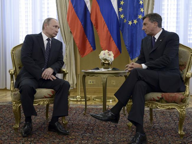 Russian President  Alexei NikolskyVladimir Putin, left, pictured with Slovenia's President Borut Pahor last month. Putin struck a conciliatory tone on a visit to the country, testing Western resolve in maintaining crippling sanctions against the Kremlin for its role in Ukraine. Picture: